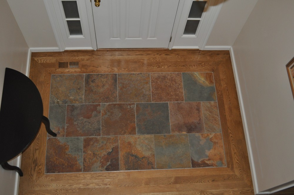 "Slate entry 'area rug' bordered by job finished white oak.  Slate was set to be the same height as 3/4"" thick hardwood ~ Chesterfield, MO"